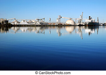 Seaport Ship Reflection - Cargo Ship Reflected near Seaport...
