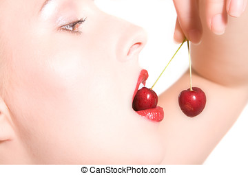 Ripe cherries - Pretty woman closeup portrait while biting...