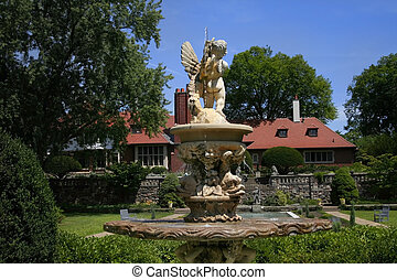Historic Cranbrook House - Statue and fountain in front of...