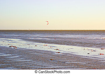 kite surfer - image of a nice calm beach or seashore with a...
