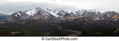 Alaskan Mountain Range - A panarama view of the alaskan...