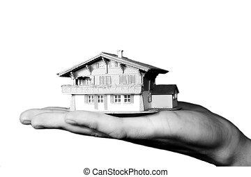 property market - a man is holding a house in his hand