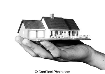 property market - a woman is holding a house in her hand -...