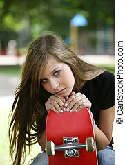 The girl with a skateboard - The young girl with a...
