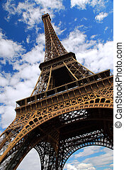 Eiffel tower on background of blue sky in Paris, France.