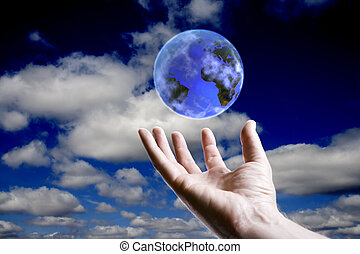 World concept - Abstract earth hoovering over an open hand...