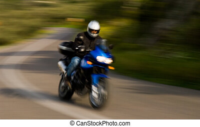 Motorcycle rider - A motorcycle rider captured negotiating...
