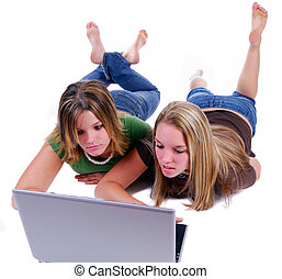 Sisters Surfing The Net - Two Teenage Sisters Using A Laptop...