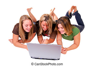Sisters With Laptop - Three Sisters Using A Laptop Computer...
