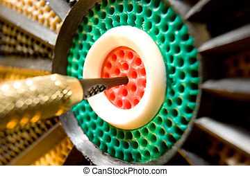 Dart board bulls eye - Closeup macro shot of a dart in the...