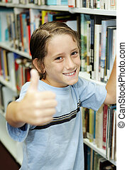 Thumbsup For Reading - An adorable school boy at the library...