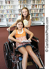 School Library - Help - Two school girls at the library. One...