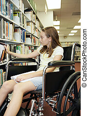 School Library - Selecting Book - A young teen girl in a...