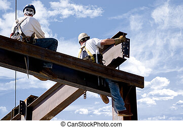 Men at Work - Two ironworkers atop the skeleton of a modern...