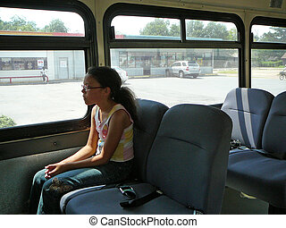 Child Riding the Bus - Child riding the bus