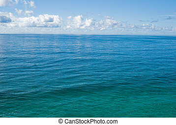 the tropical ocean - the flat and calm deep blue tropical...