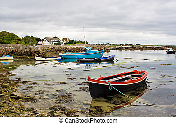 Boats on Galway Bay - Several boats tied up on the edge of...