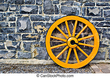 Wooden Wagon Wheel - An old yellow wooden wagon wheel...