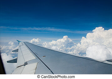 Plane ride - above the white clouds in a plane