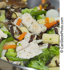 chicken stir fry white meat with vegetables on the stove