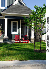 Two Red Chairs - Two Red Adirondack Chairs Outside A...