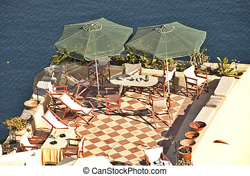 Patio and parasols - Pinkish patio and green parasols over...