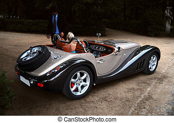 Girl in cabrio - young lady speaking with a man.Background...
