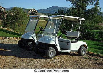 Two golf carts - Two carts in golf club early morning