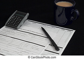 Choices - loan application, black pen, calculator and cup of...