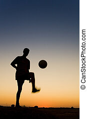 Soccer - spormans siluetthe is playing football and...