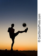 Soccer - sporman\\\'s siluetthe is playing football and...