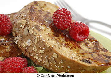 French Toast - French toast and syrup garnished with fresh...