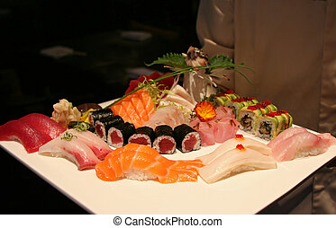 Sushi Presentation - Multiple types of sushi and sashimi,...