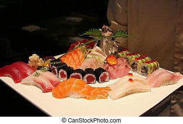 Sushi Presentation - Multiple types of sushi and sashimi,...