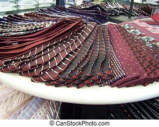 tie display - ties displayed on white table,variety patterns...