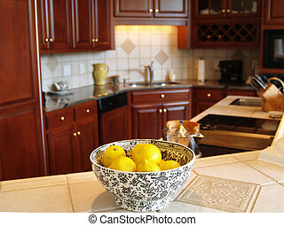 Luxury Lemons - A bowl of lemons on a marble countertop in a...