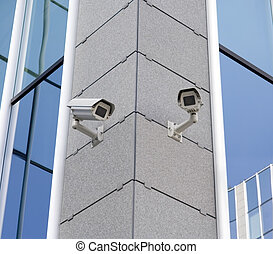 Cameras - Two security cameras attached on building corner