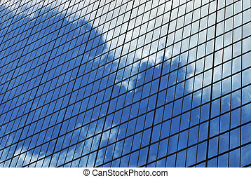 mirrored clouds - the sky is vividly reflected on large...