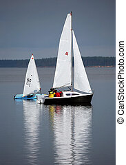 Two sailing boat at an open river. Russia