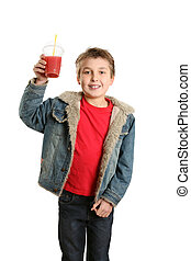 Child with fresh juice - A boy dressed in casual clothes...