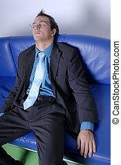 Tired businessman - A businessman dressed in suit felt...