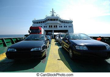 Cars on ferry - Cars are parked on a ferry.
