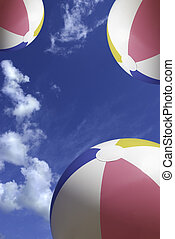 summer time - balls on the sky background with clouds...