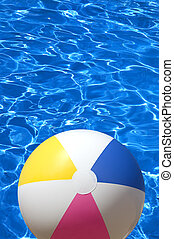 summer time - ball on the blue pool backround, focus point...