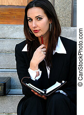 Businesswoman - attractive businesswoman looking at camera...