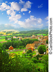 Rural landscape with hills and a small village in eastern...