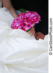 Wedding couple - Bride and groom Closeup on wedding bouquet...