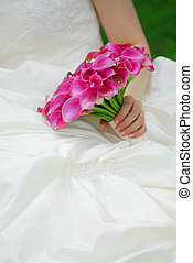 Bride with wedding bouquet - Bride in a wedding dress...