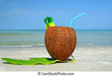 Coco drink  - Healthy drink in coconut on the sand