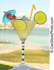 Lemon juice drink by the seashore